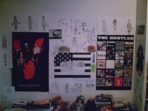 My college bedroom wall, circa 2010. Character drawings slowly enveloping my big-girl posters.